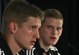 Germany's national soccer players and twins Sven and Lars Bender listen during a news conference in Tourrettes