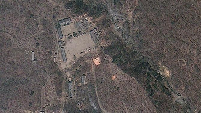In this April 18, 2012 file satellite image provided by GeoEye appears to show a train of mining carts, at the lower center of the frame, and other preparations underway at North Korea's Punggye-ri nuclear test site but no indication of when a detonation might take place, according to analysis by the U.S.-Korea Institute at Johns Hopkins School of Advanced International Studies. If getting international attention is North Korea's goal, then there is nothing quite like detonating a nuclear device to make your adversaries sit up and take notice. But experts say North Korea probably has a long way to go before it will be able to actually deploy a nuclear weapon. (AP Photo/GeoEye, File)