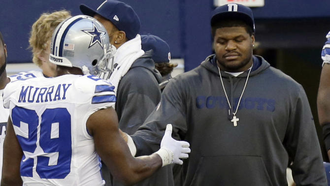 Dallas Cowboys suspended player Josh Brent, right, is greeted by DeMarco Murray (29) on the sideline during the first half of an NFL football game against the Pittsburgh Steelers Sunday, Dec. 16, 2012 in Arlington, Texas. Brent was the driver in a car crash last week, that killed teammate Jerry Brown, Jr.(AP Photo/LM Otero)
