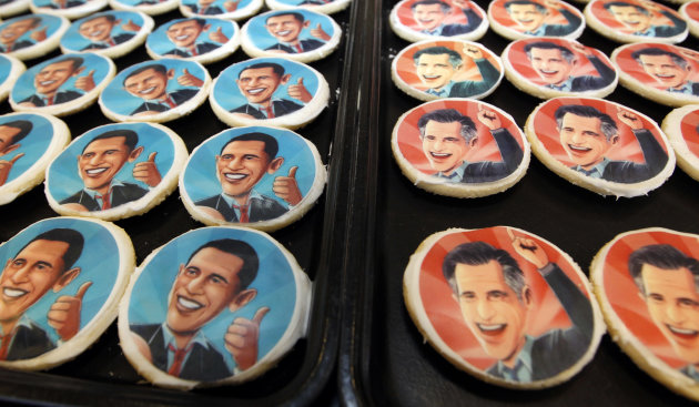 Platters of sugar cookies bearing the likenesses of President Barack Obama, left, and Republican presidential candidate Mitt Romney, are available for sale on the counter at the Oakmont Bakery on Wedn