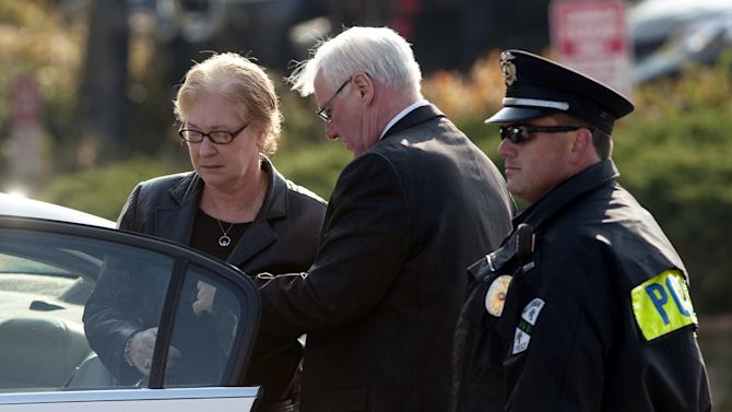 Family members arrive at the funeral of 2-year-old Maddox Derkosh at Saint Bernard Church in Mount Lebanon, Pa., on Friday, Nov. 9, 2012. Maddox Derkosh was killed Sunday after he fell from a wooden railing overlooking the painted dogs exhibit at the Pittsburgh Zoo and PPG Aquarium and bled to death after being mauled by the dogs.  The parents of Maddox Derkosh requested toy truck donated instead of flowers because their son liked to play with trucks and share them with friends. More than 3,000 have been donated, and the William Slater II funeral home says it will continue accepting the trucks even after the boy's funeral Friday morning. The family intends to donate the trucks to a charity that will distribute them to needy children on Christmas. (AP Photo/Tribune Review, Justin Merriman)  PITTSBURGH OUT