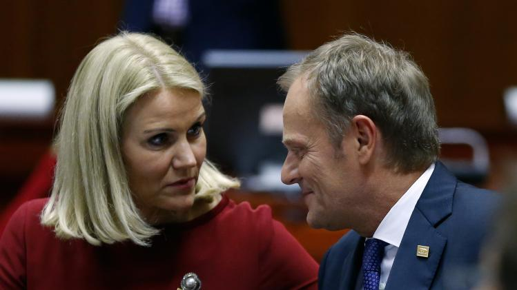 Poland's PM Tusk talks with Denmark's PM Thorning-Schmidt at the start of a European Union summit in Brussels