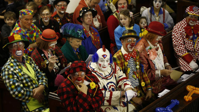Clowns sit in the pews at the All Saints Church during the Grimaldi clown service in Dalston, north London