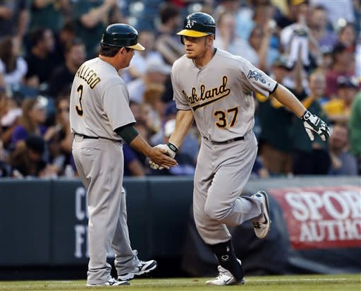 Moss homers twice in A's win at Colorado