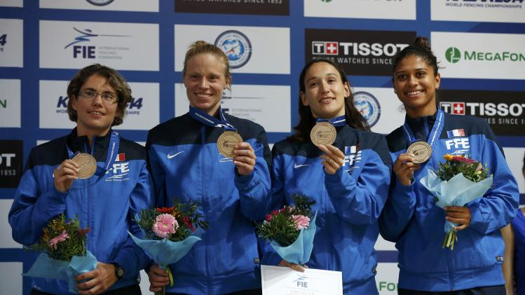 Gebet, Guyart, Maitrejean and Thibus of France's women's foil team pose with bronze medals at the World Fencing Championships in Kazan