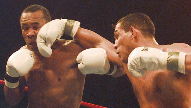 FILE - This March 1, 1997 file photo shows Hector Camacho of Puerto Rico, right, landing a punch on the chin of Sugar Ray Leonard during the second round of their IBC middleweight title fight in Atlantic City, N. J. Police in the Puerto Rican city of Bayamon say they found drugs inside the car in which former champion boxer Camacho was shot and critically wounded. Camacho was in critical condition Wednesday, Nov. 21, 2012, at the Centro Medico trauma center in San Juan. (AP Photo/Charles Rex Arbogast, File)