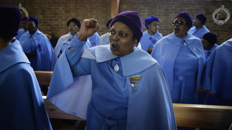 Women sing during a service for former South African President Nelson Mandela, in the Regina Mundi Church in Soweto