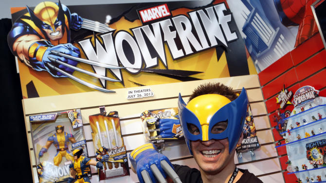 """Toy demonstrator Clayton Hodges dons the """"Wolverine Hero Mask"""" and """"Wolverine Electronic Claw,"""" based on the Marvel Comics character featured in the upcoming film """"The Wolverine"""" in Hasbro's showroom at the American International Toy Fair, Saturday, Feb. 9, 2013, in New York. (Photo by Jason DeCrow/Invision for Hasbro/AP Images)"""