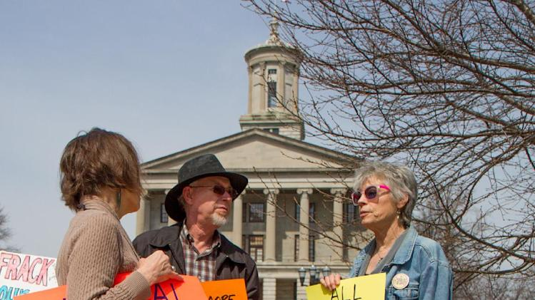 Protesters gather on the plaza across from the state Capitol in Nashville, Tenn., on Friday, March 15, 2013, to speak out against a University of Tennessee plan to allow hydraulic fracturing to extract natural gas on a state-owned tract of rolling woodland. (AP Photo/Erik Schelzig)