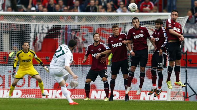 Bayer Leverkusen's Castro takes a free kick against FC Nuremberg during the German first division Bundesliga soccer match in Nuremberg
