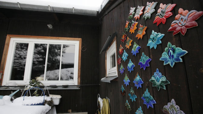 In this Feb. 8, 2013 photo a colorful ceramic decorations is seen in a little colony of Finnish-built wooden houses in the government district in Warsaw, Poland. Some have their windows boarded up as the city prepares to demolish them. The homes, erected as temporary housing in the destroyed capital just after World War II, have dwindled in number over the years from 90 to about 25. Now the surviving structures have become a point of contention between their inhabitants and a city government keen on tearing them down to make way for new developments. Now it seems about five might be saved due to the intervention of a new Finnish ambassador. (AP Photo/Czarek Sokolowski)