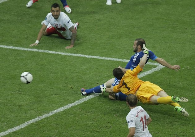 Greece's Dimitris Salpigidis scores by Poland goalkeeper Wojciech Szczesny and Poland's Marcin Wasilewski, top, and Jakub Wawrzyniak during the Euro 2012 soccer championship Group A match between Poland and Greece in Warsaw, Poland, Friday, June 8, 2012. (AP Photo/Gero Breloer)