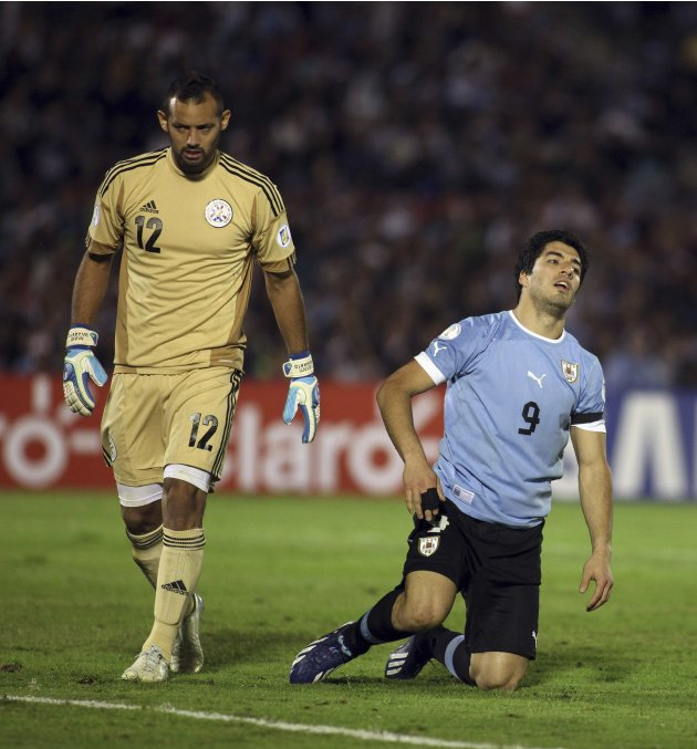 Uruguay's Suarez reacts near of Paraguay's Barreto during 2014 World Cup qualifying soccer match against Uruguay in Montevideo
