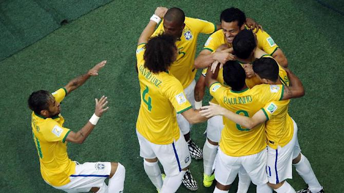 Brazilian players celebrate after Thiago Silva scored his side's first goal during the World Cup quarterfinal soccer match between Brazil and Colombia at the Arena Castelao in Fortaleza, Brazil, Friday, July 4, 2014