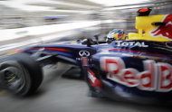 Red Bull driver Sebastian Vettel of Germany exits the garage during third free practice at the Interlagos race track in Sao Paulo, Brazil, Saturday, Nov. 26, 2011. The Brazilian Formula One Grand Prix will take place on Sunday.(AP Photo/Victor R. Caivano)