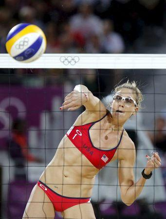 File picture shows Kerri Walsh Jennings of the U.S. spiking the ball at the women's beach volleyball gold medal match during the London 2012 Olympic Games