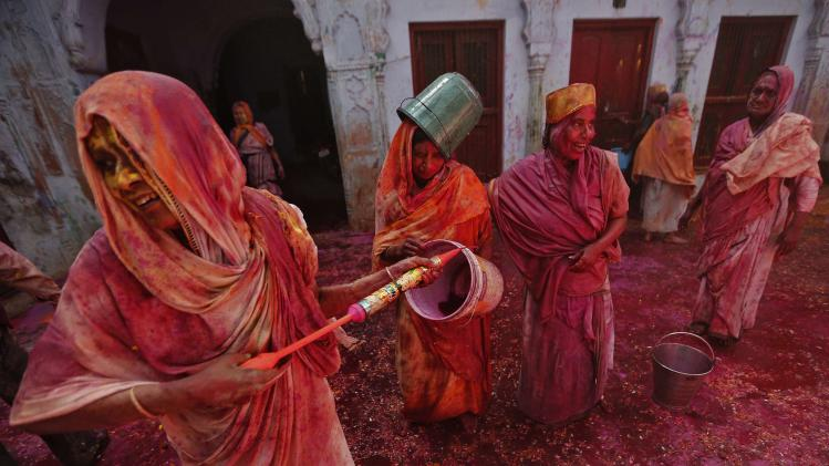 Widows daubed in colours as they take part in Holi celebrations organised by non-governmental organisation Sulabh International in Vrindavan