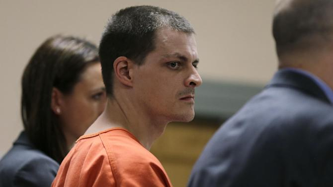 Nathaniel Kibby, 34, of Gorham, N.H. stands during his arraignment at Conway District Court in Conway, N.H., Tuesday, July 29, 2014. Kibby was charged with kidnapping Abigail Hernandez nine months ago was ordered held on $1 million bail after a brief court appearance Tuesday. (AP Photo/Charles Krupa, Pool)