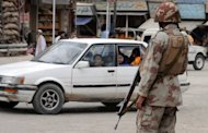 Paramilitary soldiers stand guard on a street in Quetta on. Gunmen killed four policemen in a drive-by shooting on the outskirts of Pakistan&#39;s troubled southwestern city of Quetta Saturday, police said