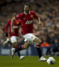 Manchester United&#39;s Ryan Giggs runs with the ball during a Premiership match against Spurs at White Hart Lane on March 4, which Man U won 3-1. Manchester United, overloaded with debt since their takeover by a billionaire American family of investors, is moving to raise cash through a US share sale