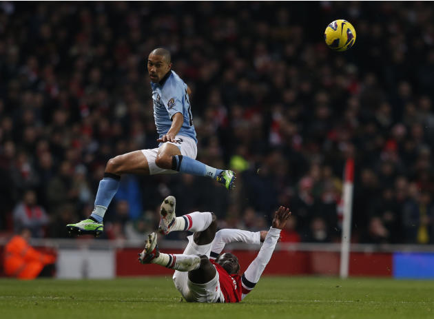 Arsenal's Sagna challenges Manchester City's Clichy during their English Premier League soccer match at the Emirates Stadium in London