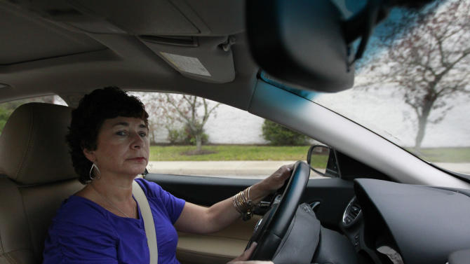 In this Thursday, Oct. 4, 2012 photo retiree Jamie Reilly, of North Providence, R.I., drives her car in North Attleboro, Mass.  Reilly left her job as a secretary at age 50, thinking her 30 years of state employment would mean good benefits during her later years. But now she said she may be forced to re-enter the workforce at age 55 because the state has put off pension increases. (AP Photo/Steven Senne)