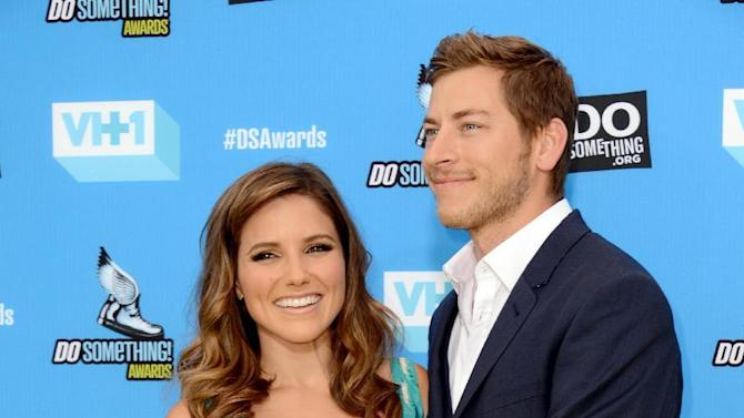 File-This July 31, 2013, file photo shows Sophia Bush, left, and Dan Fredinburg arriving at the Do Something Awards at the Avalon in Los Angeles. Fredinburg, a Google executive who described himself as an adventurer, was among the hundreds who died in a massive earthquake that struck Nepal on Saturday, April 25, 2015. (Photo by Jordan Strauss/Invision/AP, File)