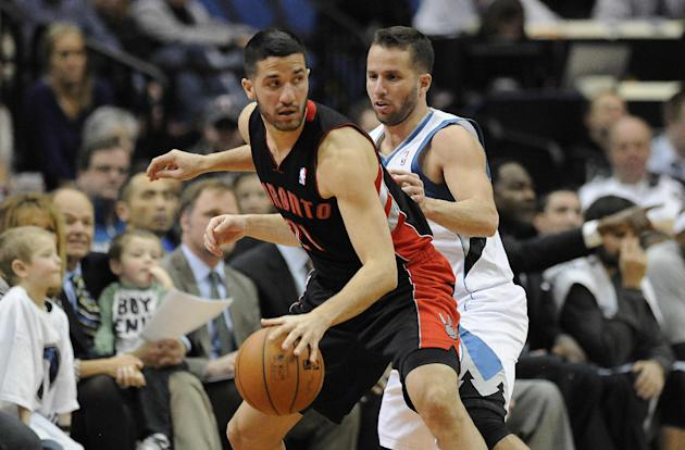 Toronto Raptors guard Greivis Vasquez (21) looks to pass the ball against the defense of Minnesota Timberwolves guard J.J. Barea (11) in the second half of an NBA basketball game, Sunday, March 9, 201