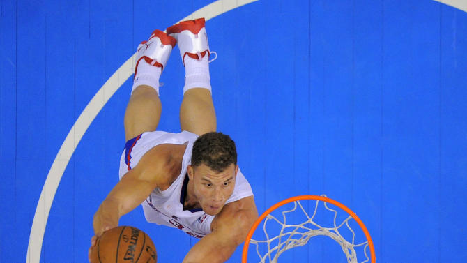 Los Angeles Clippers forward Blake Griffin goes up for a dunk during the second half of an NBA basketball game against the Utah Jazz, Saturday, Dec. 28, 2013, in Los Angeles