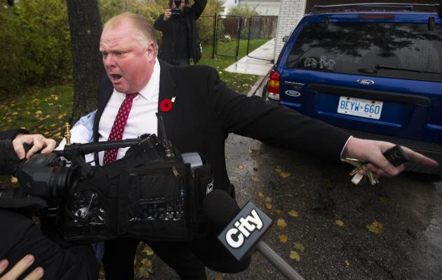 Toronto Mayor Ford yells at reporters and photographers to get off of his property in front of his house in Toronto