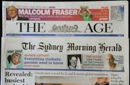 "The front pages of Australian media giant Fairfax's newspapers The Age and The Sydney Morning Herald. A shakeup which will see Australia become the first country in the world with all its flagship newspapers behind an Internet paywall has prompted declarations that the ""golden age of newspapers is dead"""