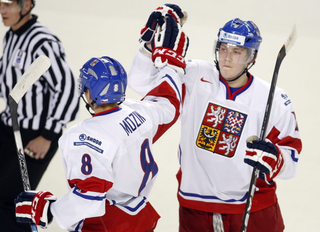 File - Czech Republic's Vojtech Mozik, left, celebrates with teammate Daniel Krejci after scoring during first period IIHF World Junior Championships hockey action against Slovakia in Calgary, Alta., Wednesday, Jan. 4, 2012.THE CANADIAN PRESS/Jeff McIntosh