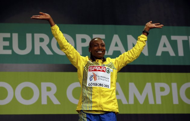Winner Aregawi of Sweden celebrates on the podium during the medal ceremony for the women's 1,500m event at the European Athletics Indoor Championships in Gothenburg