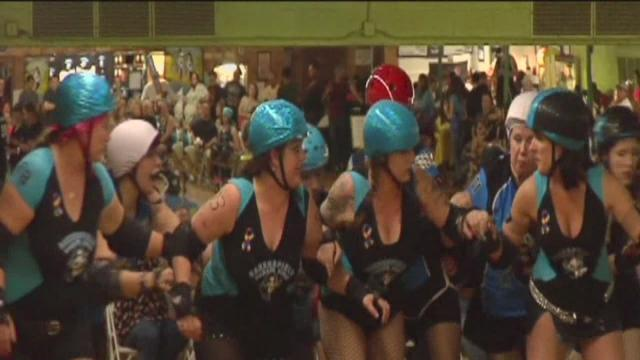 Roller derby team skates for Autism Speaks