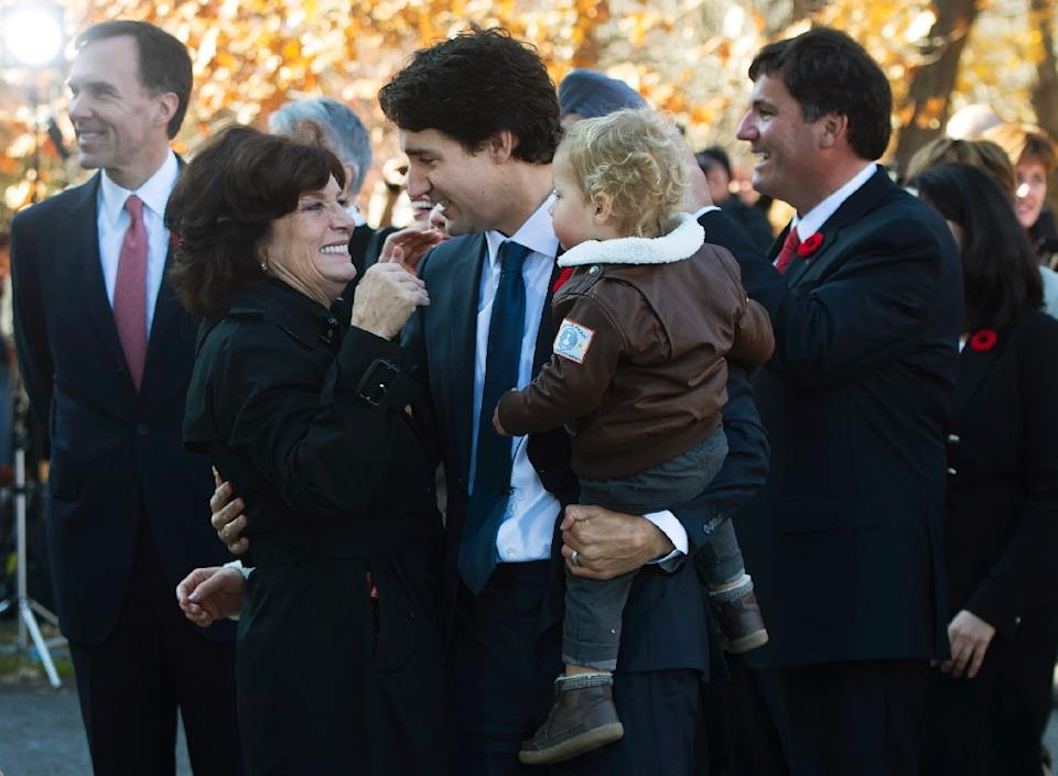 Justin Trudeau holds his son Hadrien while hugging his mother Margaret outside Rideau Hall  in Ottawa on November 4, 2015