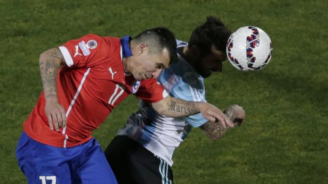 Chile's Medel and Argentina's Lavezzi head the ball during their Copa America 2015 final soccer match at the National Stadium in Santiago