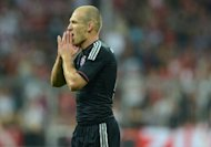 Bayern Munich's Arjen Robben, seen here in August 2012, has quickly dispelled any notion he is considering retiring due to constant injuries despite admitting he has thought about quitting in an interview with Dutch television