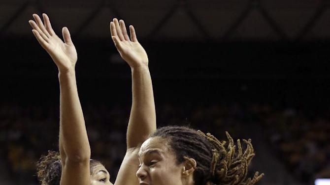 Baylor center Brittney Griner (42) drives against Kansas State guard Chantay Caron (11) during the first half of an NCAA college basketball game Monday, March 4, 2013, in Arlington, Texas. (AP Photo/LM Otero)