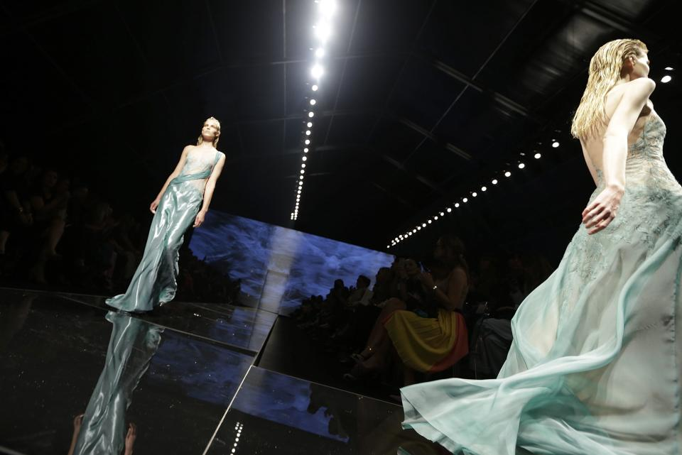 Models wear  creations part of the Alberta Ferretti women's Spring-Summer 2013 collection that was presented in Milan, Italy, Wednesday, Sept. 19, 2012. (AP Photo/Luca Bruno)