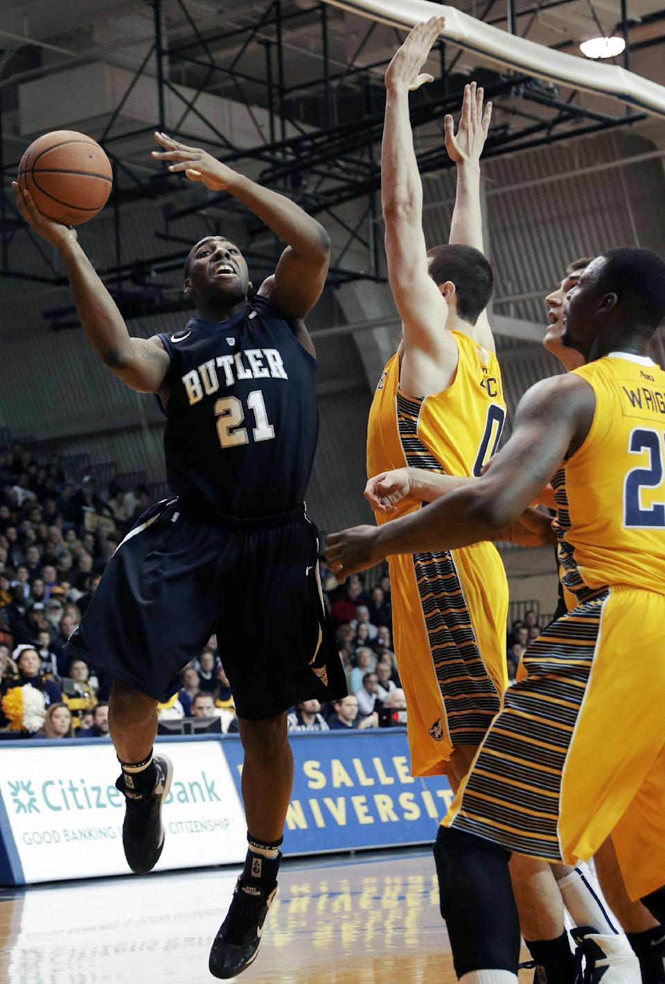 Butler's Roosevelt Jones, left, goes up for a shot against La Salle's Steve Zack, center, and Jerrell Wright during the first half of an NCAA college basketball game, Wednesday, Jan. 23, 2013, in Philadelphia. (AP Photo/Matt Slocum)