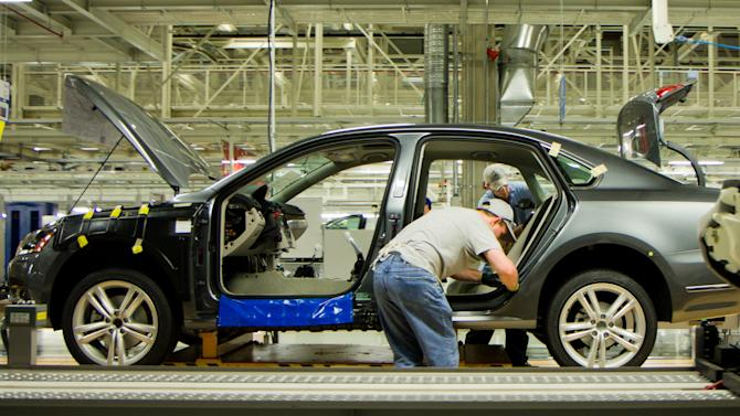 FILE - In this March 22, 2012, file photo, workers assemble a Passat sedan at Volkswagen AG's plant in Chattanooga, Tenn. The German automaker is conducting a national ad campaign to attract skilled workers to fill 1,000 new jobs at the plant this year. (AP Photo/Erik Schelzig, File)