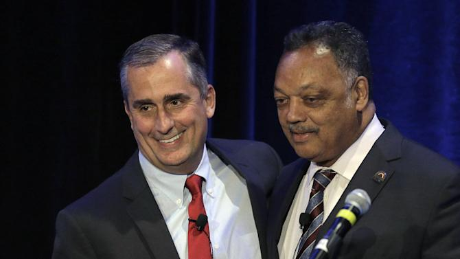 Intel CEO Brian Krzanich left, stands beside Rev. Jesse Jackson prior to speaking at the PUSHTech2020 Summit Wednesday, May 6, 2015, in San Francisco. Jackson and his Rainbow Push organization are holding the summit as part of a year-old campaign to pressure tech companies into hiring and promoting more minorities and women. (AP Photo/Ben Margot)