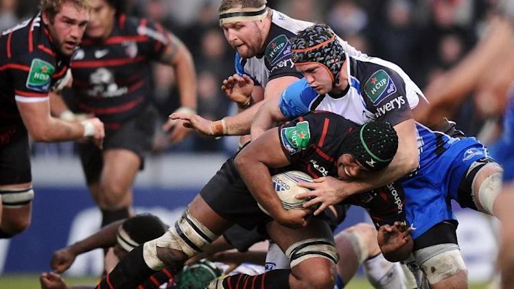 Toulouse's captain Thierry Dusautoir (2nd R) runs with the ball next to Connacht's Eoin MacKeon (R) during the European Cup rugby union match between Toulouse and Connacht on December 8, 2013 in the Ernest Wallon stadium in Toulouse