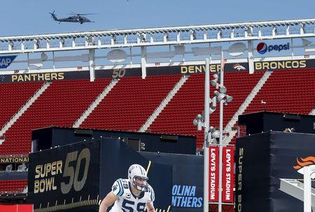A U.S. military helicopter patrols before NFL Super Bowl 50 outside Levi's Stadium in Santa Clara, California,