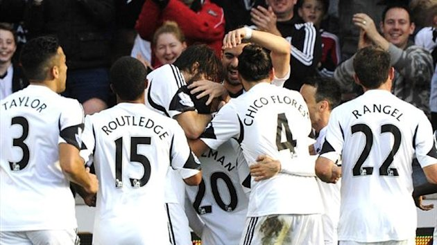 Swansea players celebrate with Jonathan de Guzman against Sunderland (Reuters)