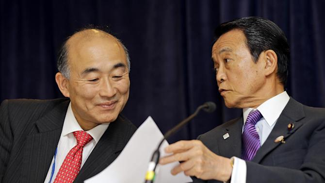 Taro Aso,, Deputy Prime Minister of Japan, Minister of Finance, and Minister of State for Financial Services, right, shows a paper to Mitsuhiro Furusawa, Vice Minister for International Affairs, during a media availability, after a meeting at the Spring Meetings of the World Bank Group and the International Monetary Fund Friday, April 19, 2013 in Washington. (AP Photo/Alex Brandon)