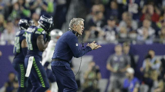 Seattle Seahawks head coach Pete Carroll applauds during the second half of NFL Super Bowl XLIX football game against the New England Patriots on Sunday, Feb. 1, 2015, in Glendale, Ariz
