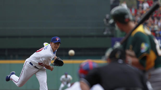 Taiwan's starter Wang Chien-ming delivers a pitch against Australia in the first inning of their World Baseball Classic first round game at the Intercontinental Baseball Stadium in Taichung, Taiwan, Saturday, March 2, 2013. (AP Photo/Wally Santana)