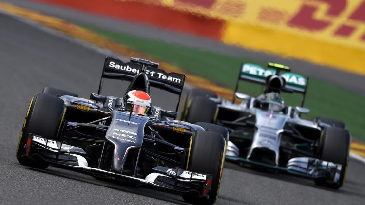 Sutil drives on the track in front of Rosberg during a practice session at the Belgian F1 Grand Prix in Spa-Francorchamps