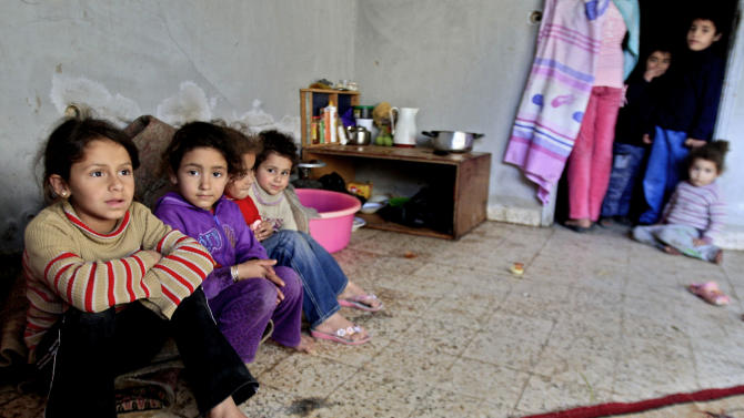 In this Tuesday, Jan. 15, 2013 photo, Palestinian children who fled their houses in the Yarmouk camp for Palestinian refugees in south Damascus, sitting inside a children library, at the Ein el-Hilweh refugee camp, in the southern port city of Sidon, Lebanon. The Palestinian exodus from Syria has also revived decades-old debate over the Palestine refugees' 'right of return' to their homes that are now in Israel, adding to the complexity the conflict whose sectarian and ethnic overtones have spilled over into neighboring countries raising fears of a regional war. (AP Photo/Mohammed Zaatari)